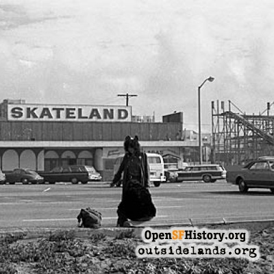 Hitchhiker in front of Skateland, 1970s