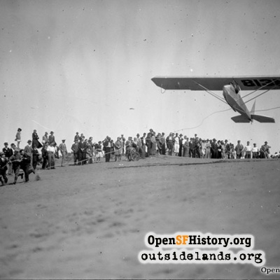 Glider being launched in Sunset District dunes, 1930s