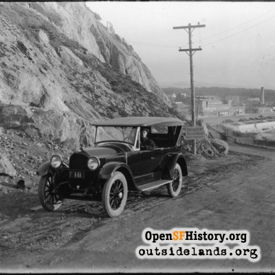 Point Lobos Ave. Auto on road below Cliff House